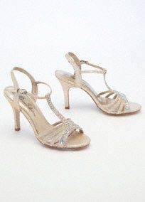 """Classic design meets modern accents in this stunning crystal T-strap sandal!  Sensational sandal features sparkling crystal T-strap detail.  Heel measures 3 1/4"""".  Ankle strap provides extra support.  Fully lined. Imported."""