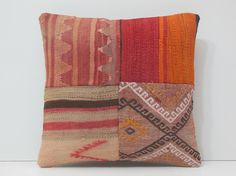 """antique rug pillow decorative rug pillow by DECOLICKILIMPILLOWS -- New pillow cover made with pieces of vintage rugs on the front, but sold as a """"vintage handmade item from the 1950s"""".  Not old."""