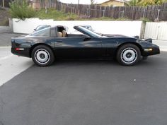 1984 black corvette with saddle leather interior + targa top:)