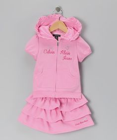 Sporty and sweet in equal measures, this set features embroidered text and kisses of ruffles. This ready-to-go getup would look darling and feel extra comfy during afternoon walks or popcorn popping.Includes zip-up hoodie and skirt60% cotton / 40% polyesterMachine wash; tumble dryImpo...