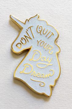 """""""You're just a day dream away"""" This little lapel pin makes the most charming accessory! Pin is available in iridescent glitter or iridescent lilac glitter. Text reads """"Don't Quit Your Day Dream."""" 1.5"""""""