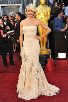 Cameron Diaz wears a Gucci gown, Salvatore Ferragamo pumps, and Tiffany & Co jewelry. ~OSCARS 2012