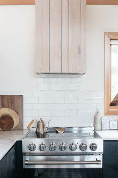 white subway tile and whitewashed wood in modern malibu kitchen. / sfgirlbybay