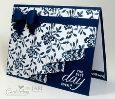 Tips, Tricks and measurements for making a  Drapery Fold card:  Use 12 x 12 DSP, and cut a panel that is 4 X 11 1/2; score at 3″, 4″, 6″, 7″, 9″, 10″ Beginning at the 3″ score (on the left), use scissors and cut diagonally up to the right side of the DSP to about 1 1/2″ down from the top; pleat on the scored lines to create the drapery effect. Use snail or glue to hold the pleats together (do not attach this piece to the front of the card yet) Place your drapery piece on the card base to…