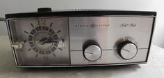 General Electric Solid State AM Radio Alarm Clock/ Faux Walnut Wood Grain and Silver from 1960's by RadiogirlCarolyn on Etsy