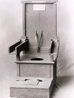 Restraint chair for violent patients This chair was used to control violent patients at the New York State asylum in the early 20th century. An unruly patient's arms were strapped into the wooded wells, feet secured to the floor, and a belt tied around the boy - sometimes a patient's head was covered with a hood.