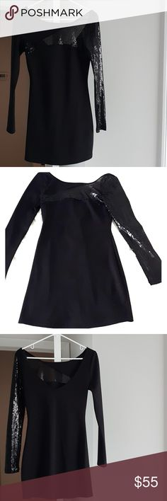 Gorgeous black sequin dress Kardashian kollection black sequin dress. Sequin across the chest and continues on to the full length of the left arm. No missing sequin, no threads visible. Kardashian kollection Dresses