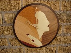 Wall Clock with Art Deco Female inlay.