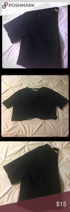 Cropped Shrug by Cato SZ XL Gorgeous black cropped sweater shrug with black sequins scattered throughout for a classic subtle touch of bling by Cato SZ XL. Euc, no rips, stains or tears💄💋 Cato Sweaters