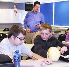 """Brandishing a Styrofoam board he wants someone to break,author Mike Mullin asks28 students in Deidre Laker's English 9 class at Batesville High School,""""Who's tough enough for this presentation?Who wants to learn some tae kwon do?"""""""