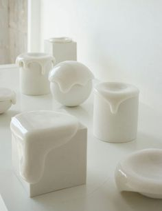 Koji Shiraya crafts simple porcelain boxes with a difference: they have oozing, overflowing lids making the container appear alive with white gelatinous liquid.