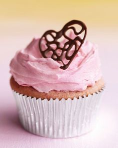 Valentine's Day Cupcakes // Raspberry Cupcakes with Pink Buttercream and Lacy Chocolate Hearts Recipe