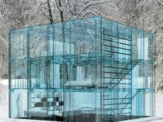 Italian design duo Santambrogio ( Carlo Santambrogio & Ennio Arosic) designed two homes, entirely constructed of a blue hued glass. Each glass house was built in two juxtaposing locations, giving both homes a unique relation of the interior to the exterior environments. Every component of these structures are pretty much all glass, even the bed frame, giving an impression of an unbroken line of vision within a space.