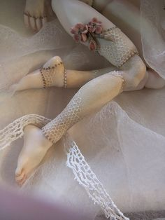 What a beautiful doll. Love the randomness of the lace!