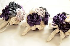 The Vintage Cabbage Rose does beautiful work. Purple and Grey Wedding Small Fabric Flower Bouquet. $65.00, via Etsy.