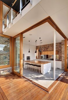 I like the idea of having a kitchen area like this. 20th Century Brick Bungalow Converted into Light-Filled Modern Home