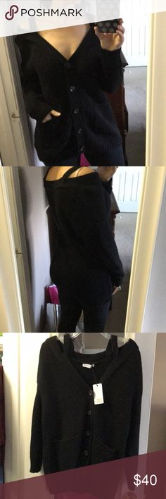 Black, oversized off the shoulder cardigan I just bought this off posh from a boutique, but sadly it doesn't fit. It's beautiful in person, pictures do it no justice! Size Small, but it's supposed to be an oversized fit, it ends up fitting more like a Medium/oversized medium. Last pic is boutique pic of the rust colored cardi. Asking less than I paid, just trying to recoup some. Sweaters