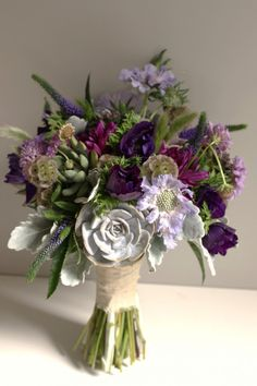 www.studioblush.com #bouquet purple bridal bouquet with succulents, dusty miller and purple anemones