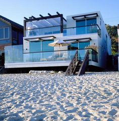 When You Can Own This House Life Truly Is A Beach Gorgeous Waterfront Home Architecture Luxury Dream Seaside With Tall Gl Wall And Fence
