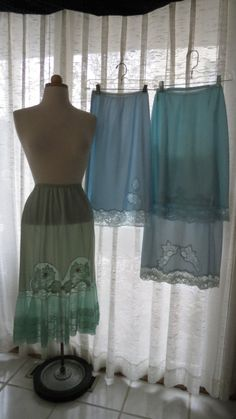 PRETTY TRUE VINTAGE BLUE HALF-SLIPS FROM THE FIFTIES AND EARLY SIXTIES