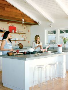 this is a precious, simple kitchen - love the wall paper in the background!
