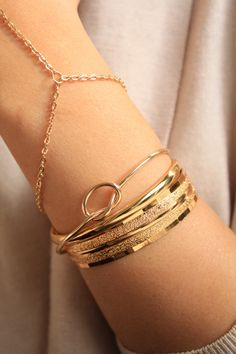 A personal favorite from my Etsy shop https://www.etsy.com/listing/260989568/gold-knot-bangle-silver-knot-bracelet