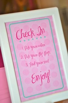 Check in sign. I would change the task to include dropping their cell phone off in a basket and enjoying the company they are with...pick up cell phones later.