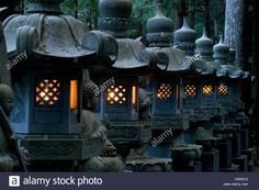 Download this stock image: Row of lighted stone lanterns in the Okunoin Temple cemetery at Koyasan (Mount Koya, Wakayama, Japan - c8gec2 from Alamy's library of millions of high resolution stock photos, illustrations and vectors.