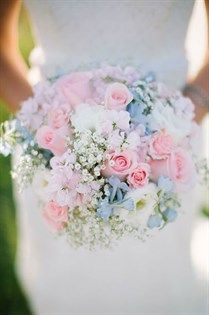 This bright bouquet of pink roses interspersed with gypsophila is sure to bring a smile to any brides face.