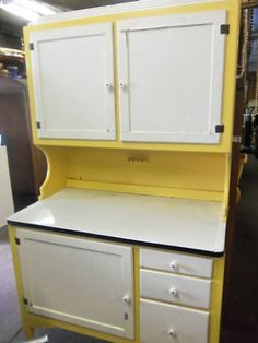 Antique Hoosier Cabinet- my grandma had one of these, it was all white. my husband just bought me one Aug 2013, it is the natural wood, but it reminds me of her