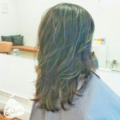 Long layered cut with soft wave.