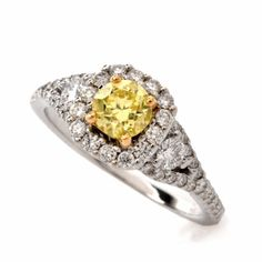 This estate engagement ring in antique style pyramidal design is crafted in white gold with a touch of yellow gold applied to the center-stone setting. This engagement ring of captivating aesthetic is centered with a GIA CERTIFIED round cut d Estate Engagement Ring, Yellow Diamond Engagement Ring, Antique Engagement Rings, Gia Certified Diamonds, White Gold, Fancy, Stone, Natural, Green