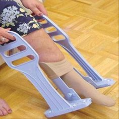 The Heel Guide Compression Stocking Aid acts as a guide and keeps the client's foot in position while putting on compression hose. The wide cone allows lymphedema, edema, and larger patients to put on the hose with ease. The handles are 17 inches high which prevents a person from needing to bending over to handle the device. They are available for $39.95. They are manufactured by North Coast Medical.