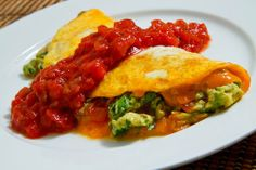 """Guacamole Omelette - Cool and creamy guacamole cooked in an omelette with plenty of melted cheese that is served topped with salsa. Definitely a """"TEXAS Omelette """", yum! Avocado Recipes, Healthy Recipes, Egg Recipes, Healthy Food, Diet Recipes, Healthy Eating, Brunch Recipes, Breakfast Recipes, Mexican Food Recipes"""