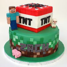 https://flic.kr/p/otiMZD | Minecraft cake | The tiles are modeling chocolate. The animals and the guy are gumpaste.