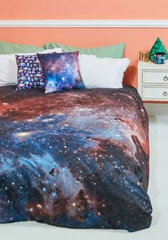 One Nebula at a Time Duvet Cover Set in Full/Queen | Mod Retro Vintage Decor Accessories | ModCloth.com  It's easy to give your abode cosmic character - all you need to do is add this patterned duvet cover! Featuring a pink, purple, blue, and black design of the Carina Nebula, this fanciful duvet cover and its matching pillowcases are one small step for your bedroom's comfort and one giant leap for your entire dwelling's aesthetic.