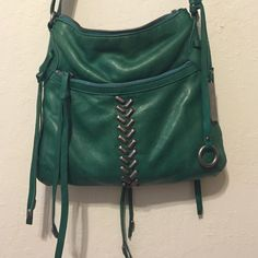 Emerald green lucky brand purse Emerald green long strap, cross body or long at the side. Lucky brand. Used but still in good condition. Lucky Brand Bags Crossbody Bags