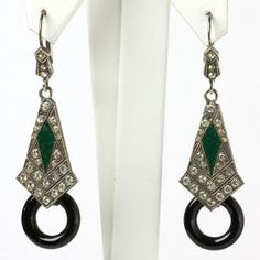 These Art Deco earrings are fashioned from onyx glass hoops and panels adorned with emerald enamel diamanté.