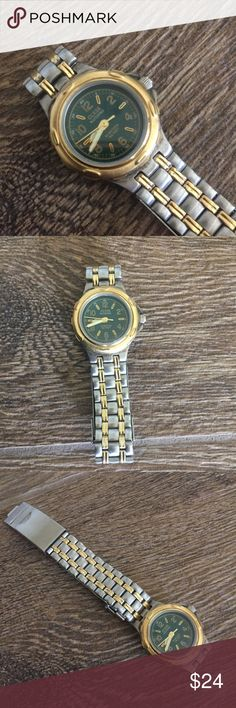 Vintage Guess Waterpro Watch 1996 Vintage Guess Waterpro Watch. Marked 1996. Silver and gold in color with an olive green face. 50 meters and 165 feet. Needs new battery. Guess Accessories Watches