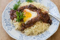 Recipe: Eggs in puttanesca with angel hair pasta