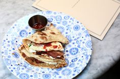 How about this for breakfast? smoked streaky bacon with two fried free-range eggs wrapped in a freshly baked naan; accompanied by a little cream cheese, chilli tomato jam and fresh herbs... #food #travel | Dishoom – The Sexiest Restaurant in London
