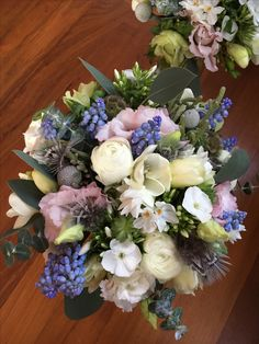 Spring wedding bouquet of ranunculus , muscari, phlox and roses at Lingholm Estate