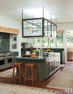 metal framed glass cabinet over kitchen island