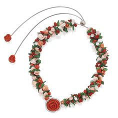 18 Karat White Gold, Coral, Carved Nephrite and Diamond Necklace, Michele della Valle The fanciful flowering vine composed of numerous carved coral flowers with carved nephrite leaves, accented by round diamonds weighing approximately 2.70 carats, length 31 inches, adjustable, signed MdV.