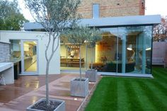 Edwardian house near London with a very exciting modern glass extension opening onto a courtyard garden