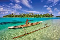 A boy canoeing in crystal clear water - Papua New Guinea  Gudmundur Fridriksson, Gummi Fridriksson, Paga Hill Estate, Paga Hill Development Company, PHDC, PNG  Read my blog: http://www.gudmundurfridrikssonblog.com/island-tourisms-last-frontier/