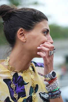 Giovanna Battaglia in a gorgeous printed floral dress and stacks of bracelets.  Love her gold necklace