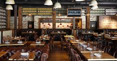 """Parlor flaunts a rooftop beer garden, an expansive ground-level patio, and a sweeping indoor dining space. Whet your appetite with """"craziest bread"""" (house beer bread with garlic, shallots,..."""