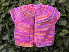 Pink Rose Toddler Vest | This bright and colorful knit vest will look adorable on any little lady.
