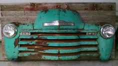 This front grille is mounted on reclaimed wood from a grain truck box. It has all new 12 volt lights that light up with a 12 volt source. The hood piece is removable with the latch. There are two secured hooks on the back to hang on a wall. This would be great for a man cave, work shop or restaurant.
